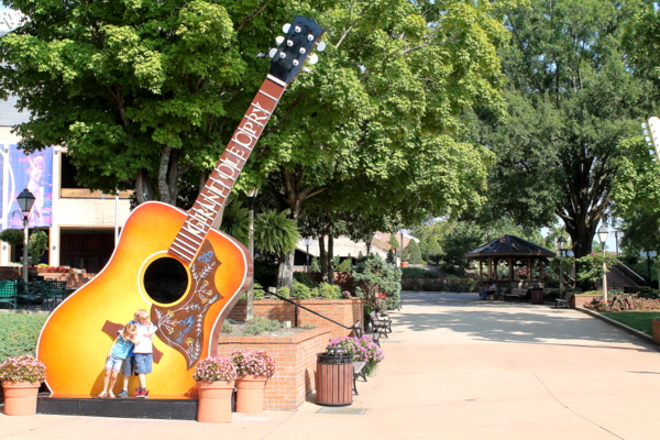 Grand Ole Opry big guitar and the kids